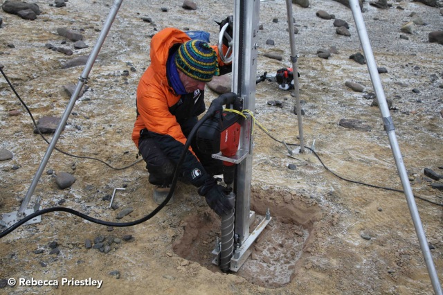 Warren Dickinson setting up the drill. Drilling in permafrost is no easy task.